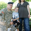 Beverly Police Patrolman Josh Pickett is a sergeant in the Massachusetts National Guard and is being deployed to Afghanistan for a year. This will be his fourth deployment in his 15 years with the military. Here he poses with his wife, Nancy, who is seven months pregnant and their four-year-old son, Josiah. Photo by Deborah Parker/July 30, 2010
