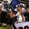 Danvers' Dan Skinner is brought down by Revere's Devin Tango during last night's held at Deering Stadium. Photo by Deborah Parker/September 25, 2009