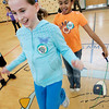 Peabody: Fourth grade classmates from the Captian Samuel Brown School, Hannah Durkin and Taylor Tenn, try to jump rope at the same time while participating in the American Heart Association's Jump Rope for Heart program Wednesday afternoon. The program helps to raise money for the Association and this is the sixth year that the school has participated. Photo by Deborah Parker/Salem News Wednesday March 18, 2009.