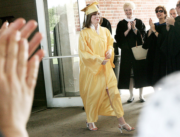 Peabody: Bishop Fenwick teachers clap for students, such as Alexandra Ford, as they exit the school and line up to take their seats during the start of graduation Friday. Photo by Deborah Parker/May 22, 2009