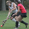 Beverly's Allie Hagen tries to move the ball out of Beverly territory against Saugus' Taylor Corrado during Monday afternoon's game held in Beverly. Photo by deborah parker/october 25, 2010