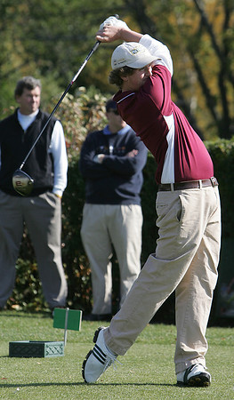 Ben Mosse of Gloucester tees off on the first hole during the Northeastern Conference Golf Open at Tedesco Country Club in Marblehead yesterday. Photo by Deborah Parker/October 20, 2009