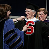 Salem: Red Sox legend, Johnny Pesky, opens his arms to hug Salem State President Patricia Maguire Meservey, after being awarded a Doctor of Humane Letters Honorary Degree during the Salem State Graduation ceremony Saturday. (No name on presentor, not in program). Photo by Deborah Parker/May 16, 2009