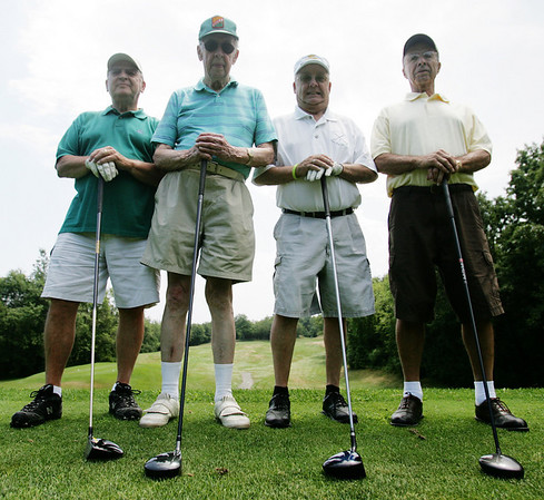 Ken Ring, is a 95-year-old golfer who still plays once a week with a group of friends at the Olde Salem Greens. From left, is Joe Martel, Ken Ring, Spike Thibeault and Bob Caron. Photo by Deborah Parker/July 12, 2010