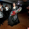 Boxford resident Christina Eckert is revealed after winning a makeover as part of the Boxford Elementary School Trust's fashion show fundraiser held at the Ipswich Country Club Wednesday evening. photo by deborah parker/february 3, 2009