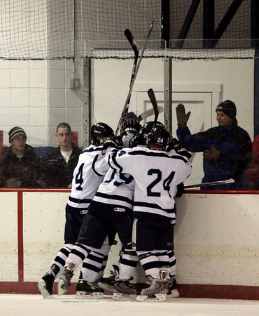 Peabody: Peabody celebrates after scoring on Beverly during Saturday's season opener held at McVann-O'Keefe Rink. Photo by Deborah Parker/Salem News Saturday, December 13, 2008.