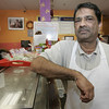 Salem: Milind Divadkar, owner of the New England Soup Factory on Washington Street,  is originally from  Mumbai, India, the site of recent terrorist attacks,and still has lots of family there.Photo by Deborah Parker/Salem News Friday, November 28, 2008