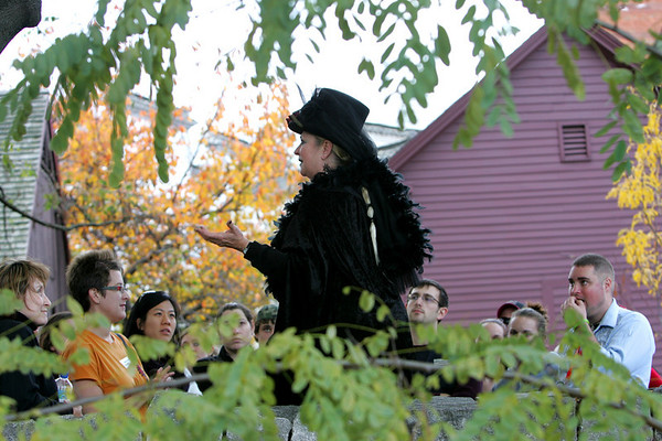 Mollie Stewart of Spellbound tours leads a group through the Burying Point while on a tour of Salem early Halloween evening. Photo by Deborah Parker/October 31, 2009