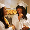 Salem Academy Charter School seniors Tamara Efstratios and April Belis, laugh together before the start of their graduation ceremony held at the Salem Waterfront Hotel in Salem Friday evening. Photo by Deborah Parker/June 18, 2010