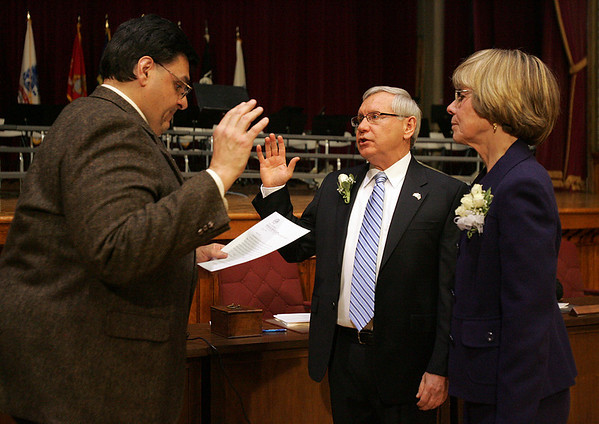 Standing next to his wife, Dorothy, Mayor Michael Bonfanti is sworn in by City Clekr Tim Spanos during last nights inauguration held at Wiggins Auditorium at City Hall. Photo by Deborah Parker/January 4, 2009