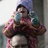 Marblehead: Nathalie Forsythe, 5, of Marblehead sits on her dad Danny's shoulders, to get the best view to wave to Santa during the Christmas parade in Marblhead Saturday. Photo by Deborah Parker/Salem News Saturday, December 06, 2008