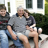 Beverly: Paul Hayes relaxes on the front porch of his home with his two sons, Mike, 11, left and Ryan, 13. Hayes received a new kidney in August from a teen donor who was killed in an accident. He says he feels very, very, lucky. Photo by Deborah Parker/May 15, 2009