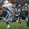 Danvers' Eric Burgos looses control of the ball while being sacked by Swampscott's Patrick Costin during Saturday's game held at Swampscott. Photo by Deborah Parker/October 24, 2009