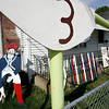 The Gaudet family loves the Patriots so much Robert hand makes wooden figures for the Patriots. He's painted a Patriots player, made a large goal post and oversized football with the number 12, for Tom Brady. Photo by Deborah Parker/October 2, 2009