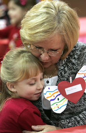 Davina Decandia of Saugus gets a hug from her grand daugther Brianna Brown, 6, of Peabody during a special Valentine's day brunch held at the McCarthy Elementary School Friday morning. Photo by Deborah Parker/February 12, 2010