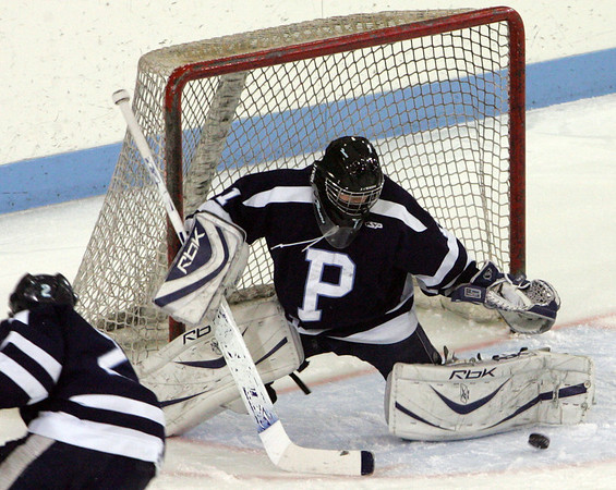 Peabody's Derek Savage defends the goal against Winthrop during last night's Division 1 North Semifinal game held at Chelmsford Forum Arena. Photo by Deborah Parker/March 1, 2010
