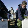 Peabody: Daniel Smith, 10 left, and Ali Demeo, 10, both of Peabody lay wreaths on the graves of two Revolutionary War solidiers at the Old Burial Ground Saturday morning. A group of Peabody kids with the help of Gerry Gaetjens, retired USAF, placed wreaths on five graves. <br /> Photo by Deborah Parker/Salem News Saturday, December 13, 2008