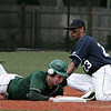 Pingree's Lamar Rey is unable to make the out as Hamden Hall's Rich ( no first name on roster) slides in between the base and Rey during Saturday's New England Small School Baseball Championships held at Salem State College. Photo by Deborah Parker/May 23, 2009