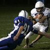 Danvers: Peabody's Nick Hiou escapes a tackle by Danvers' Dan Skinner during last night's game at Deering Stadium at Danvers High School.<br /> Photo by Deborah Parker/Salem News Friday, October 03, 2008