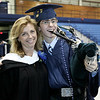 Peabody Veterans Memorial High School graduating Senior Alvaro Duarte poses for a picture with his favorite teacher, Lawrie Bertram. Photo by Deborah Parker/June 12, 2009