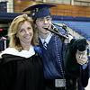 Peabody Veterans Memorial High School graduating Senior Alvaro Duarte poses for a picture with his favorite teacher, Lawrie Bertram. Photo by Deborah Parker/June 12, 2009