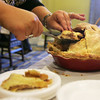 Gayel Cote of Landmark at Oceanview Assisted Living cuts a piece of pie to be judged yesterday at Essex Park's Annual Fall Pie Baking Contest. Photo by Deborah Parker/November 17, 2009
