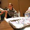 Erin Bogan of Salem receives an H1N1 vacination from Wendy York of Salem during a clinic at Salem High School Wednesday evening. The clinic was held for children 18 months to 18 and was also available for pregnant women and caretakers of babies. Photo by Deborah Parker/December 9, 2009