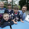 From left, Antonia Valente, 6, Katie Moloney, 12, Joey Valente, 6, Maddie Mazuzan, 9, Georgia Mazuzan, 5, and Hunter Calef, all of Salem, pose for a picture with the new principal of the Horace Mann School, Kevin Andrews, during a cookout to celebrate the beginning of the school year. Photo by Deborah Parker/September 16, 2010<br /> , From left, Antonia Valente, 6, Katie Moloney, 12, Joey Valente, 6, Maddie Mazuzan, 9, Georgia Mazuzan, 5, and Hunter Calef, all of Salem, pose for a picture with the new principal of the Horace Mann School, Kevin Andrews, during a cookout to celebrate the beginning of the school year. Photo by Deborah Parker/September 16, 2010