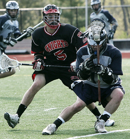 Wenham: Hamilton-Wenham's Steve Dangora is defended by North Andover's Matt Taylor during their game held at Gordon College Friday afternoon. Photo  by Deborah Parker/May 8, 2009