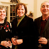 Salem: From left, Wendy Linares, Maureen Benson and David Benson, all of Danvers enjoy a drink together while at the Salem Rotary auction to benefit the scholarship fund held at Hamilton Hall Friday. Photo by Deborah Parker/Salem News Friday March 6, 2009.