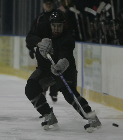 Marblehead's Ben Koopmen moves the puck down the ice during a schrimmage held at Salem State Monday evening. photo by deborah parker/december 6, 2010