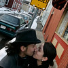 Salem: John Rivera of Salem and Megan Chilson of Lynn steal a kiss outside of In A Pig's Eye near the No Busses sign. Photo by Deborah Parker/Salem News Friday March 6, 2009.