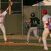 Masco's Evan Bunker throws to Sam Schwartz for the out against Duxbury's Joe Coyne in the Eastern Massachusetts Championship State semifinals Division 2 game held at Alumni Field in Lowell Tuesday evening. Photo by Deborah Parker/June 15, 2010