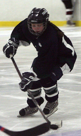 Pingree's Meaghan Souza takes control of the puck during last night's game against Groton. Photo by Deborah Parker/January 27, 2009