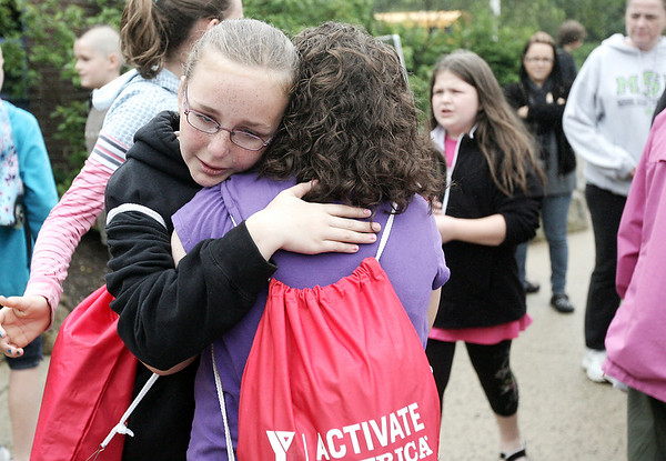 Graduating fifth graders, Lindsay Fanning, left, and Jillian Bloomer hug one another outside of Hannah Elementary School at the end of the last day of school Wednesday afternoon. Photo by Deborah Parker/June 24, 2009