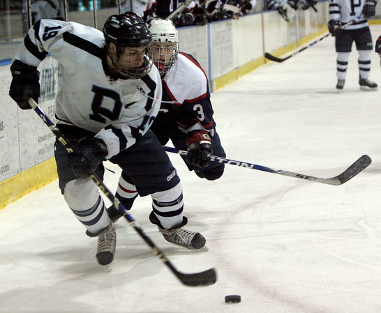 Salem: Peabody's Elijah Cohens fights off tLincoln-Sudbury's Sean Ashe during their state tournament game in Division 2 North quarterfinals held at Salem State Friday. Photo by Deborah Parker/Salem News Friday February 27, 2009.
