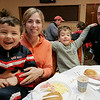 Beverly: The Mercier family, from left, Henry, 5, Diane, Michael, 6, and Michael enjoy a serving of green eggs and ham along with pancakes while the Italian Community Center Saturday morning. The Kiwanis Club held a breakfast, complete with characters and free books,  to celebrate Dr. Seuss' 105th birthday. Photo by Deborah Parker/Salem News Saturday, March 21, 2009.