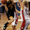 Danvers: Bishop Fenwick's Lizzy Trainor is defended in front of the net by Reading's Alison Stager during last night's Division 2 North playoff semifinal held at St. John's. Photo by Deborah Parker/Salem News Wednesday March 4, 2009.