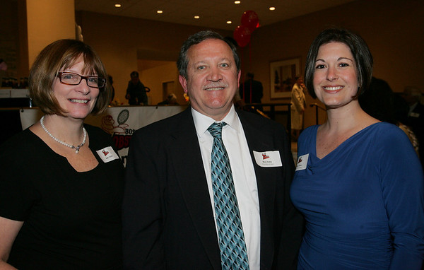 From left, Beth and Richard Foley along with Emily Daley, all of Poland Springs Beverages, attend the Boston Lobsters kick off for the 2010 season held at the Crowne Plaza Boston North Shore Friday evening. Photo bY Deborah Parker/April 16, 2010