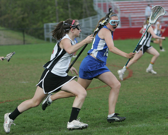 Marblehead's Meg Collins is defended by Danvers' Katie McKenna during yesterday's game held at Marblehead High School. Photo by Deborah Parker/May 4, 2010