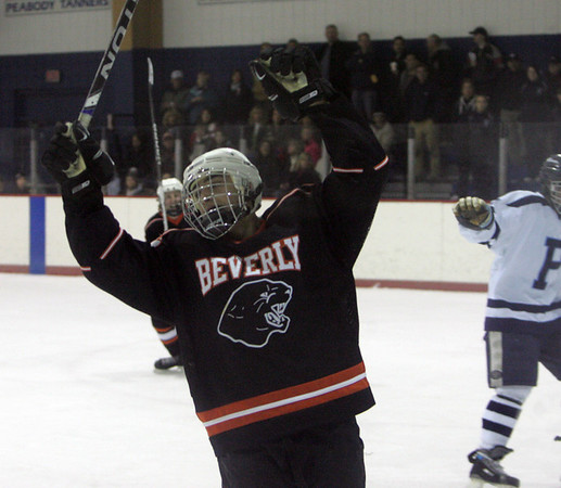 Beverly's Troy Cabral celebrates after Beverly scored on Peabody during Wednesday night game at Mcvann-O'Keefe Rink in Peabody. Photo byDeborah Parker/December 23, 2009