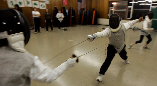 Peabdoy: Rafeal Rivera, 11, of Peabody works on a drill during the Tanner City Fencing club practice held at Higgins Middle School Wednesday evening. Coach Molly Sullivan Sliney is a former Olympian and partner coach, Jane Carter is a Pan American games gold medalist. Photo by Deborah Parker/Salem News Wednesday, December 17, 2008.