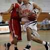 Beverly: Beverly's Curtis Manuel is defended by Salem's Bryan Ortiz in front of the net during last night's game at Beverly High School. Photo by Deborah Parker/Salem News Friday, February 13, 2009.