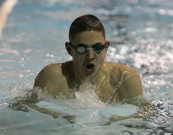Caleb Bower of the St. John's swim team works through a drill at an early morning practice at the Danvers YMCA Wednesday morning. photo by deborah parker/decemeber  7, 2010