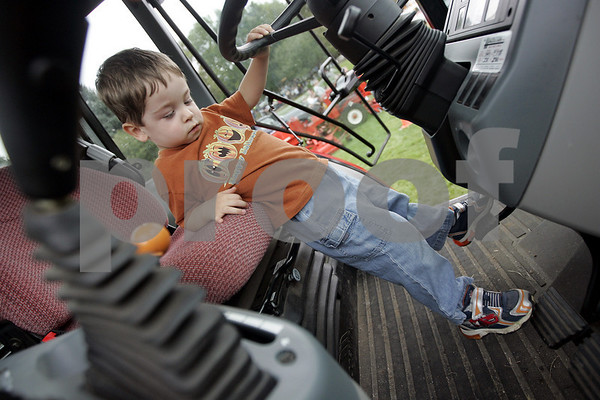 Danvers: Jacob Tyler Smith, 3, of Danvers is just a little to short to be driving tractors just yet but that didn't stop him from trying to reach the peddles during Truck Day at Endicott Park Saturday. The event, which was sposered by the town Recreation Department featured vehicles covering police motorcycles to school buses, to cement trucks.<br /> Photo by Deborah Parker/Salem News Saturday, September 13, 2008