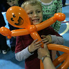 Michael Berrigan, 4, of Middleton hugs his new pumpkin man balloon hat while attending the 25th Annual Middleton Pumpkin Festival Saturday morning. Photo by Deborah Parker/October 24, 2009