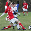 Masco's D.J. Clark and Peabody's Vinnie McMahon fight for control of the ball during Monday's game held at Peabody. Photo by Deborah Parker/November 2, 2009