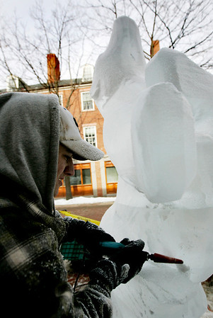 Salem: Chris DiCarli of Ice Effects carves out a replica of a carving by Inuit artist Nuna Parr in front of the Peabody Essex Museum as part of Salem's annual chocolate and ice sculpture festival, called Salem's So Sweet. In addition to the various ice sculptures around town, stores are offering lots of chocolate menu items, free samples, and wine tastings. The event lasts through February 14th. Photo by Deborah Parker/Salem News Saturday February 7, 2009.