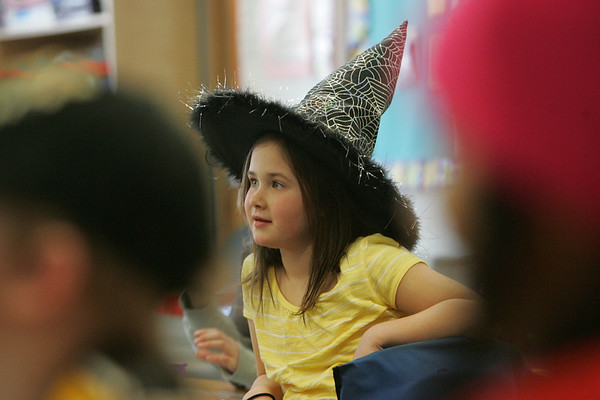 On January 28, students at the Ayer Elementary School could donated a dollar to the American Red Cross for Haiti relief and were able to wear a crazy hat to school. Here first grade student Abby Cotraro  listens in glass. Photo by Deborah Parker/January 28, 2009