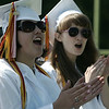 Saludictorian Erin McLean and valedictorian Catherine Bekel cheer on their classmates as they receive their diplomas at Danvers High School's graduation ceremony Saturday afternoon. Photo by Deborah Parker/June 6, 2009